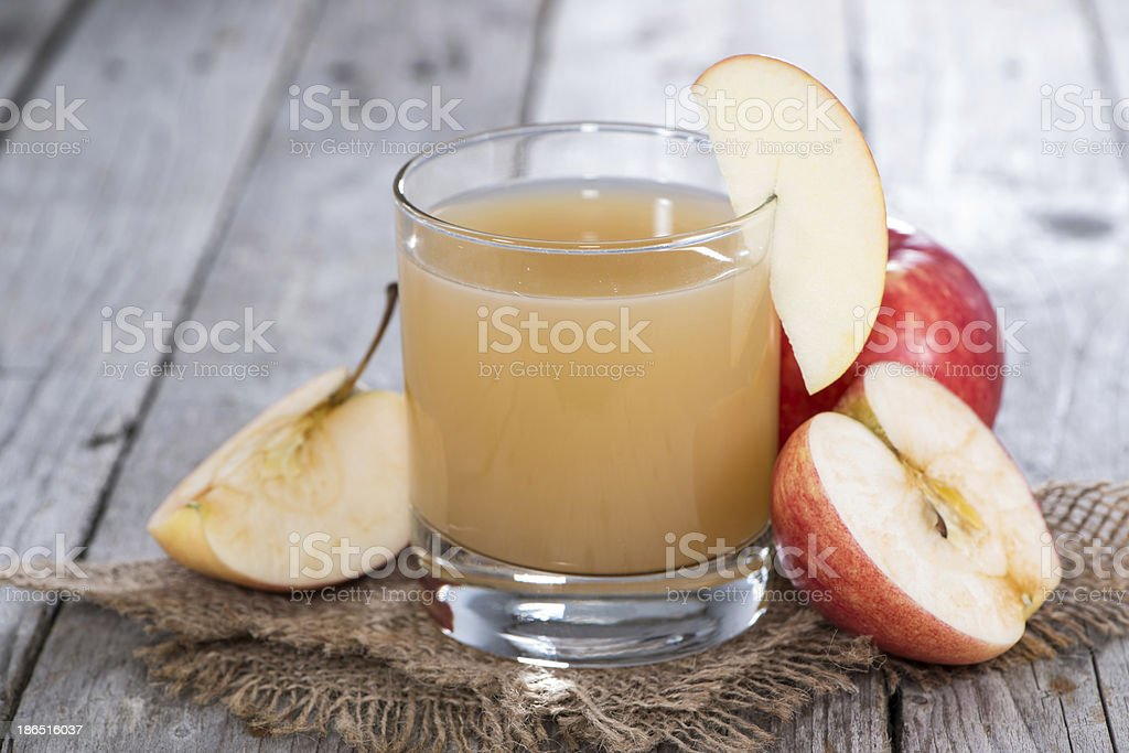 Glass filled with fresh Apple Juice royalty-free stock photo