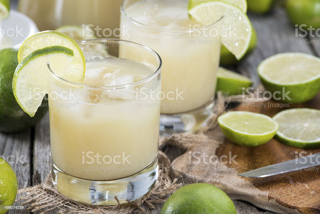 Glass filled with Lime Juice stock photo