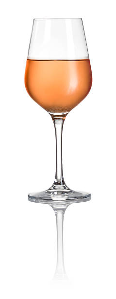 Glass filled with rose wine on a white background stock photo