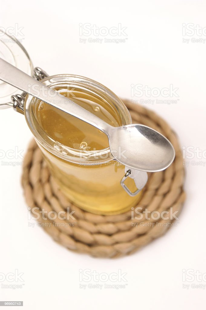 glass filled with sweet honey royalty-free stock photo