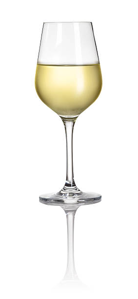 Glass filled with white wine on a white background stock photo