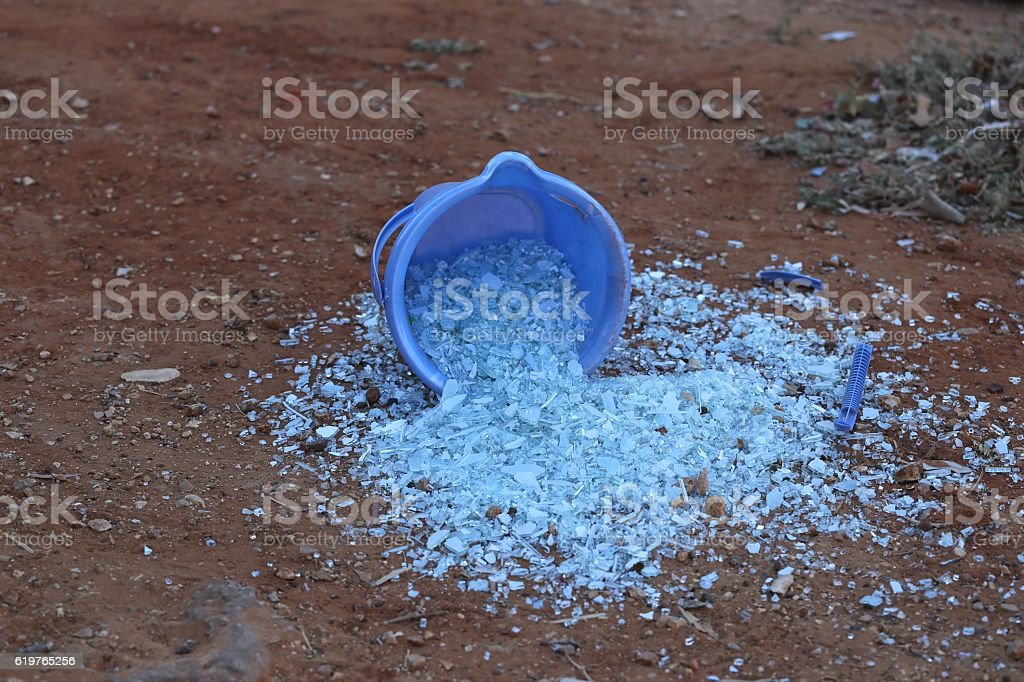 Glass Fragments Spread From a Bucket. stock photo