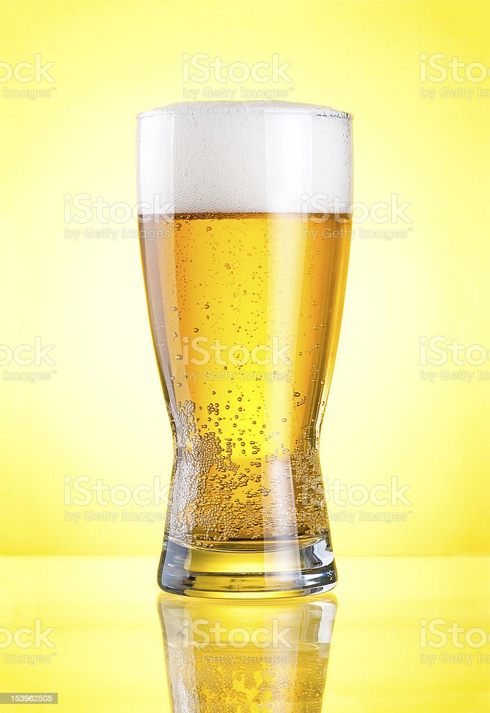 Glass fresh lager beer close-up royalty-free stock photo