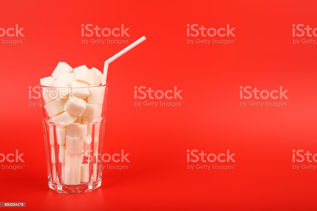 Glass full of sugar cubes royalty-free stock photo