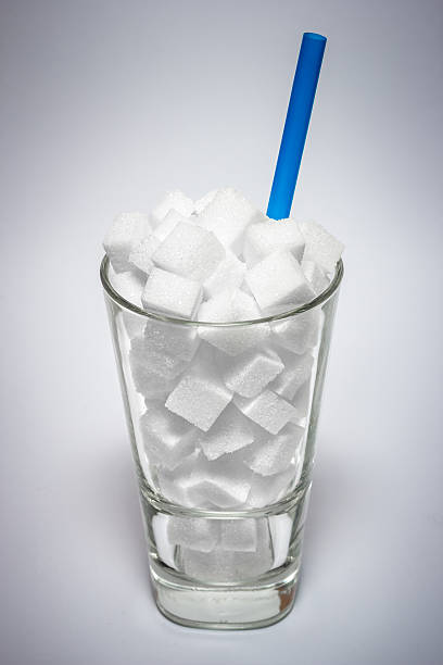 Glass full of sugar cubes - unhealthy diet concept. – Foto
