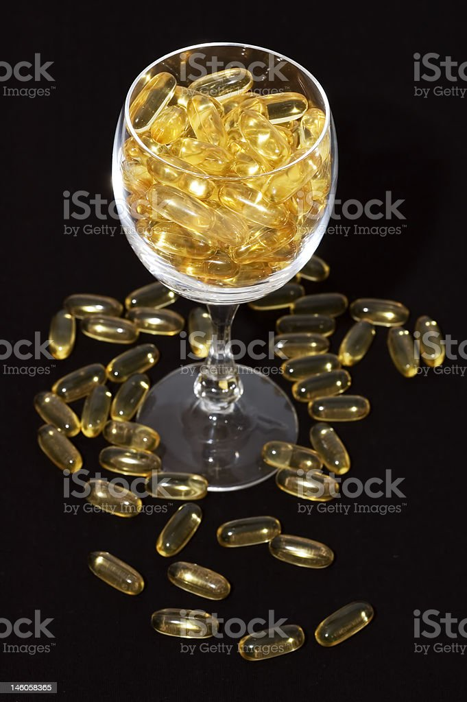 Glass full of vitamins royalty-free stock photo