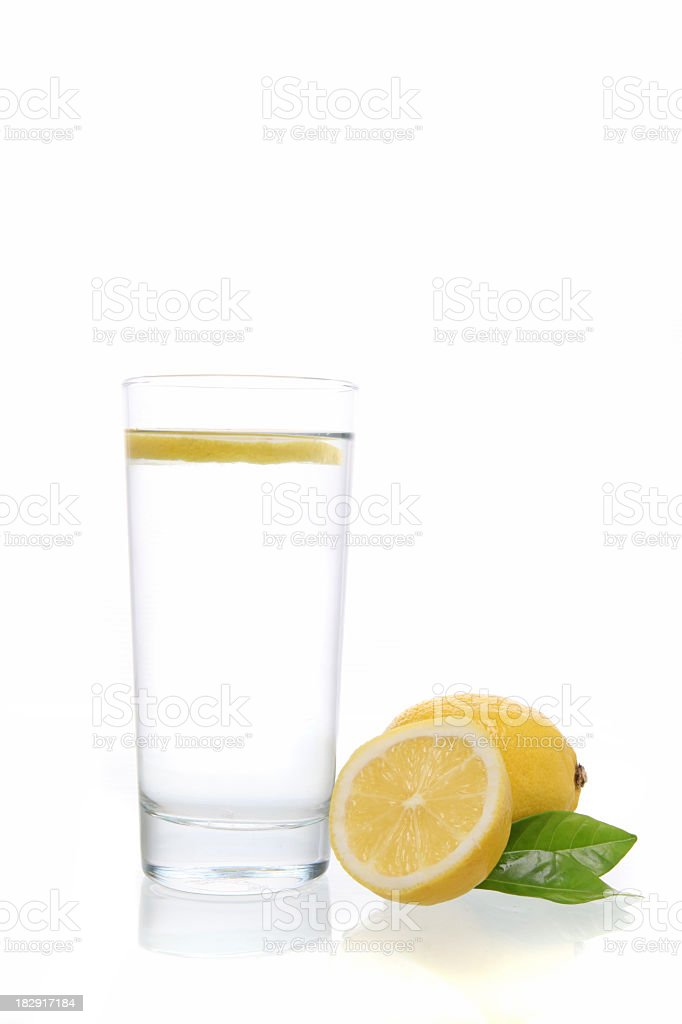 A glass full of water and lemon royalty-free stock photo