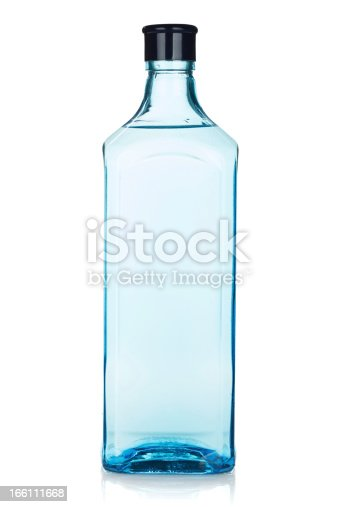 Glass gin bottle. Isolated on white background