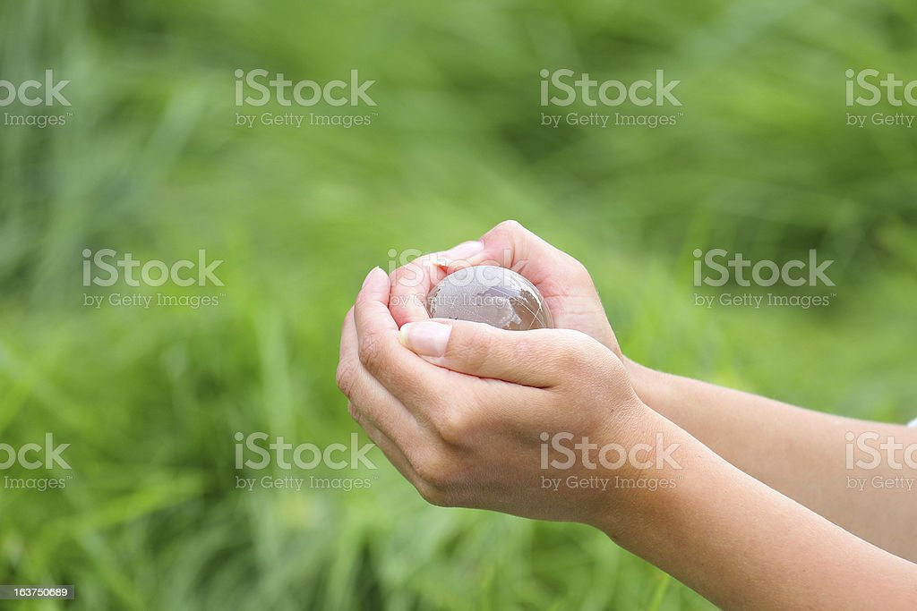 glass globe in hand royalty-free stock photo