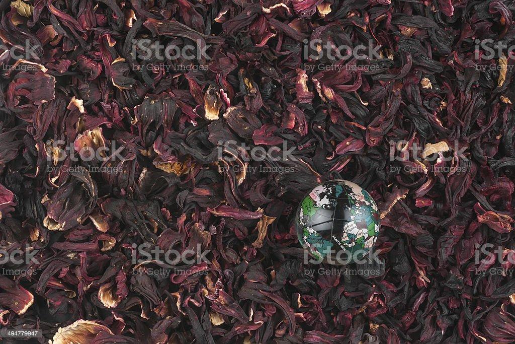 Glass globe lying on hibiscus stock photo