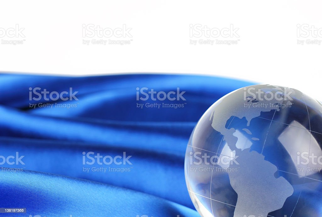 Glass globe on fabric royalty-free stock photo