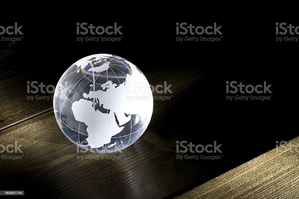 Glass globe on table stock photo