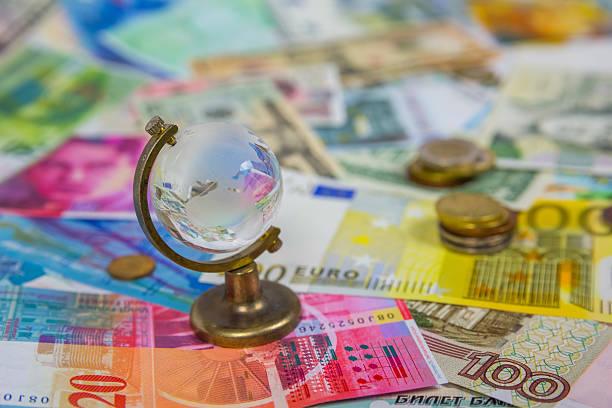 Glass globe on the bills background stock photo
