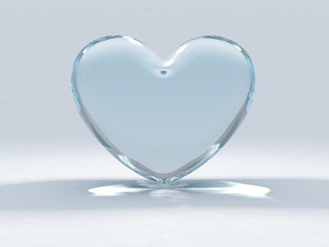 Glass heart set on a blue and white background