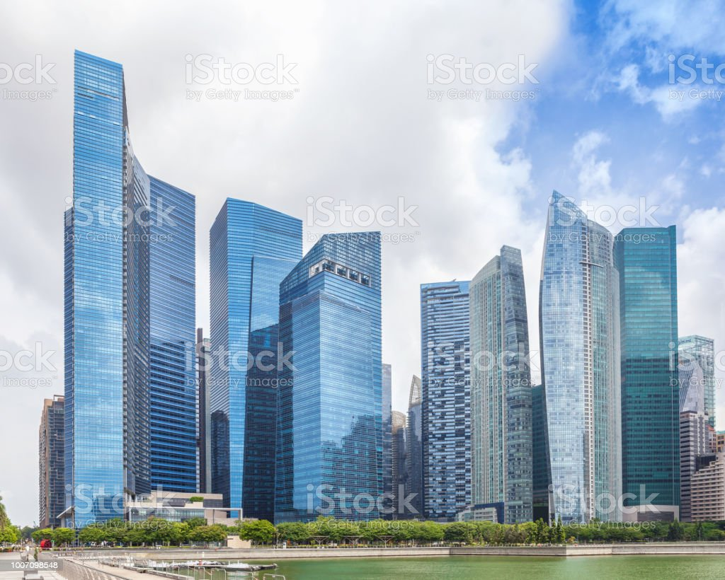 Glass high skyscrapers in the center of Singapore on the waterfront. stock photo