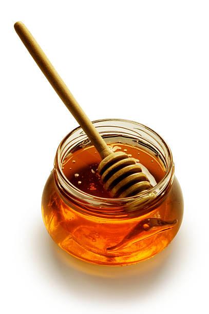 Glas Honig mit Stöcke – Foto