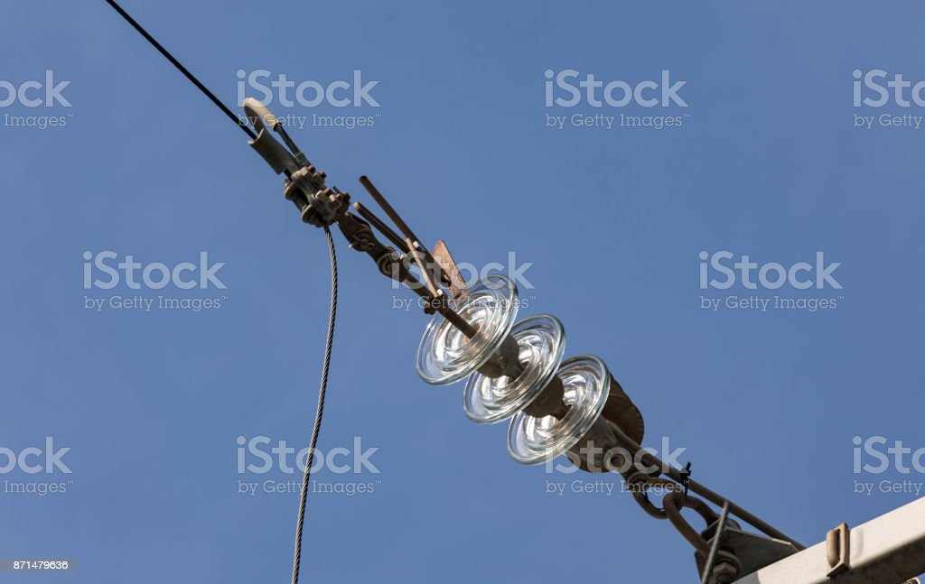 Glass insulator on the power line stock photo