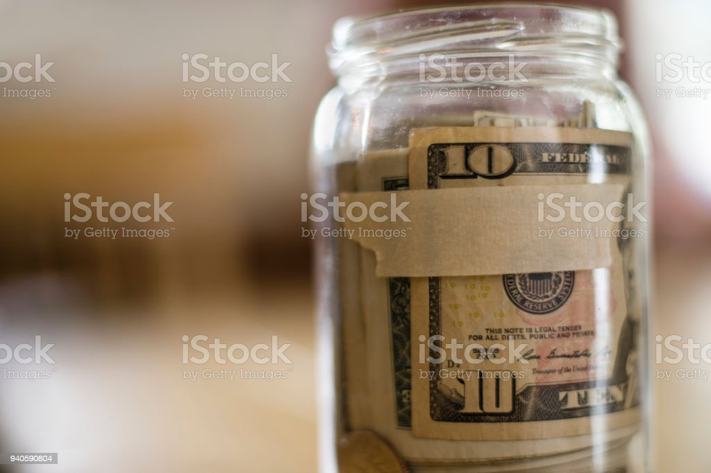 Glass Jar Filled with U.S. Currency stock photo