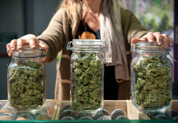 Glass jar full of Cannabis Sativa Glass jar full of Cannabis Sativa for sale at a market stall. recreational pursuit stock pictures, royalty-free photos & images