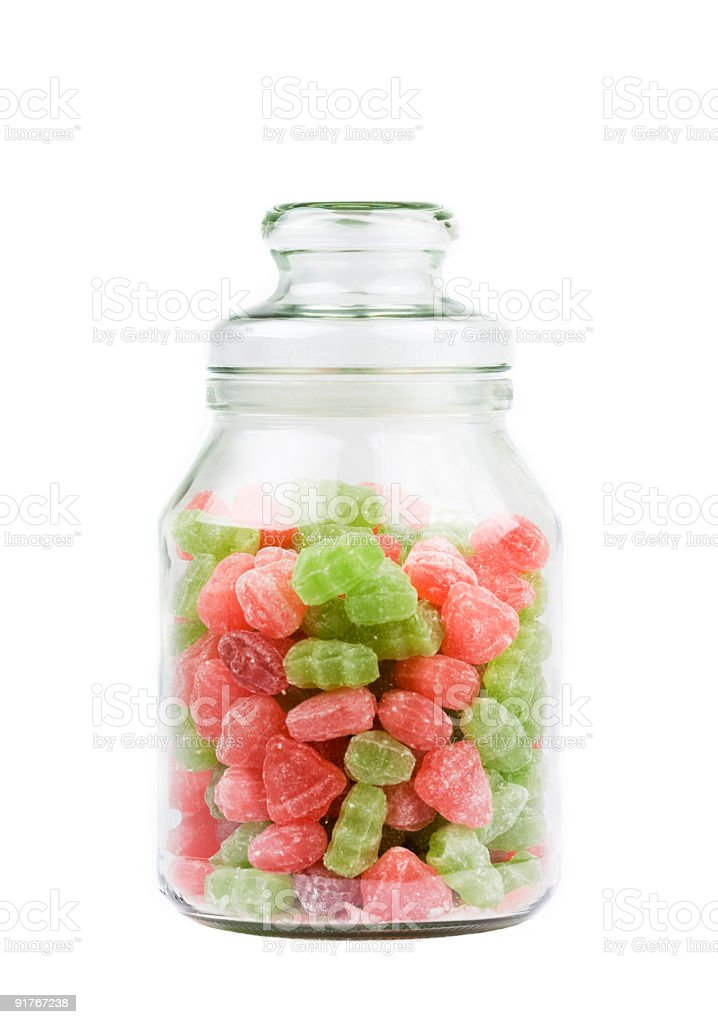 Glass Jar of candy sweets over white royalty-free stock photo