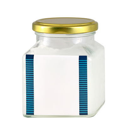 Glass jar of petroleum jelly with blank label isolated on white