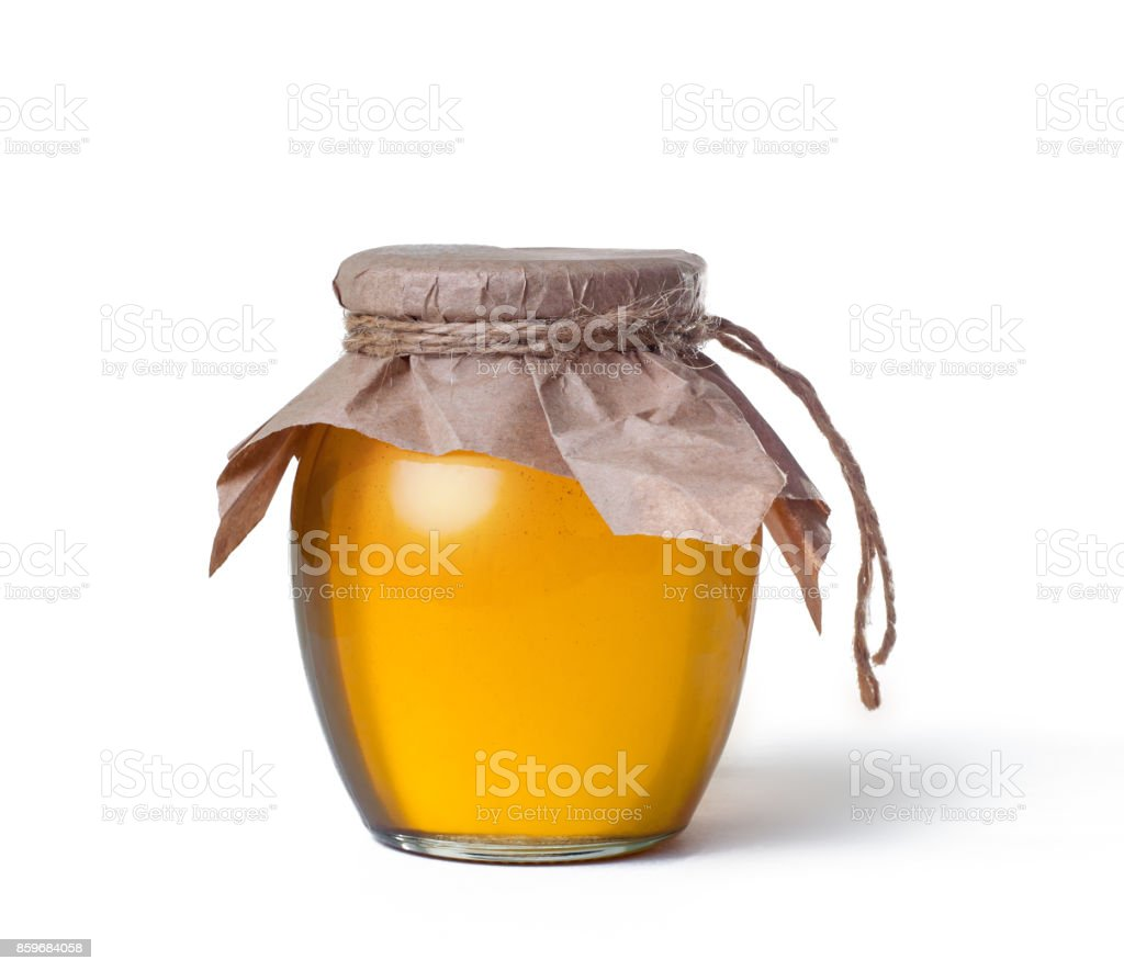 glass jar of sweet honey isolated on white background stock photo