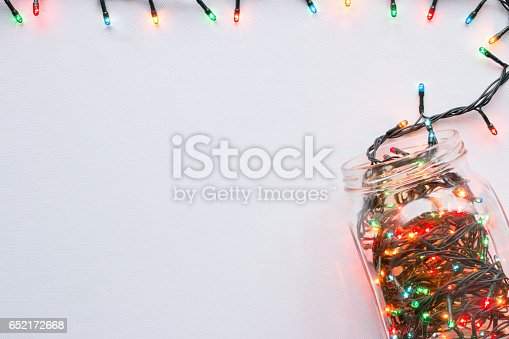 istock glass jar with a glowing garland border top view on a white background 652172668