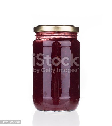 istock Glass jar with berry jam. 1221757240