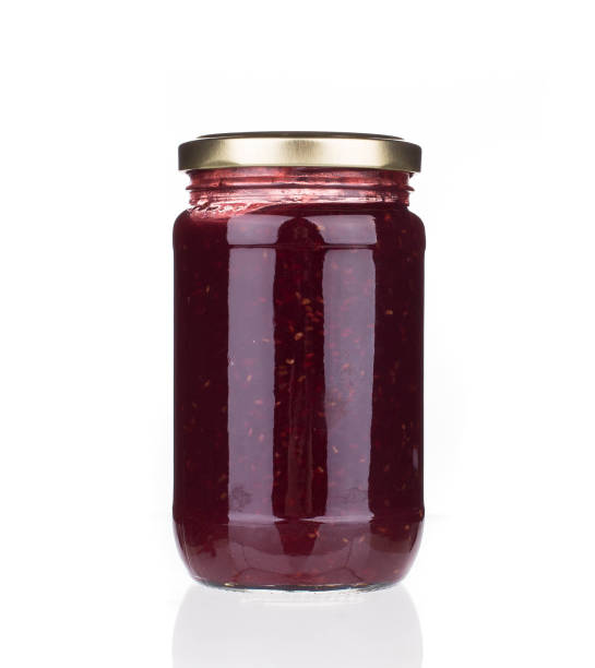 glass jar with berry jam. - jam jar imagens e fotografias de stock