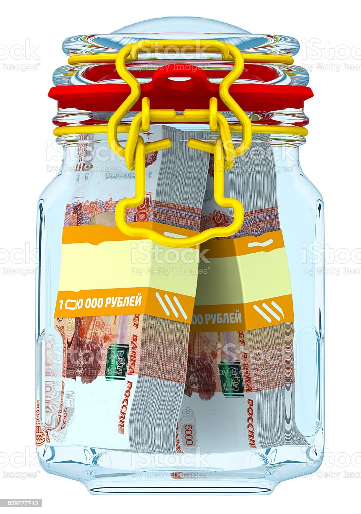 Glass jar with bundles of 5,000 Russian rubles banknotes stock photo