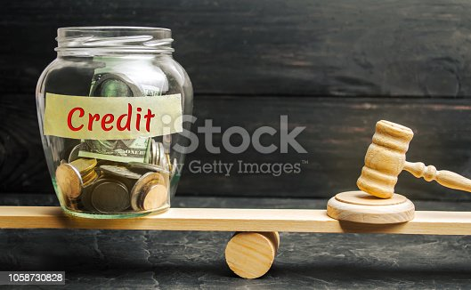 1024130248istockphoto A glass jar with coins and the inscription