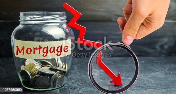 istock Glass jar with coins and the inscription
