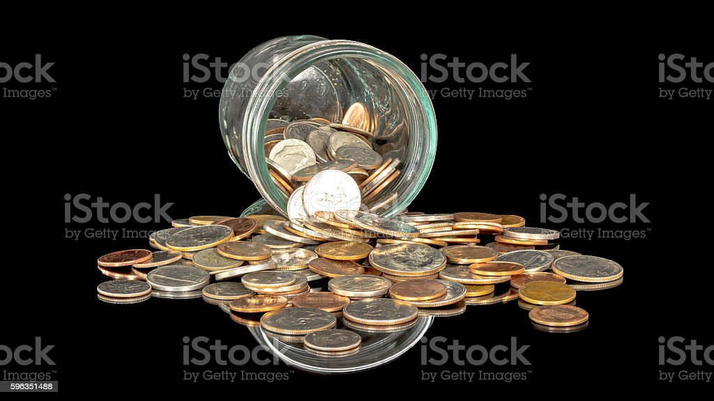 Glass jar with coins spilled out on a table royalty-free stock photo