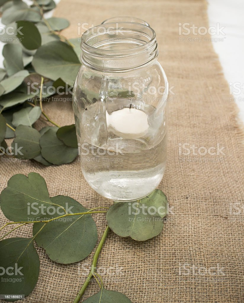 Glass Jar with Floating Candle stock photo