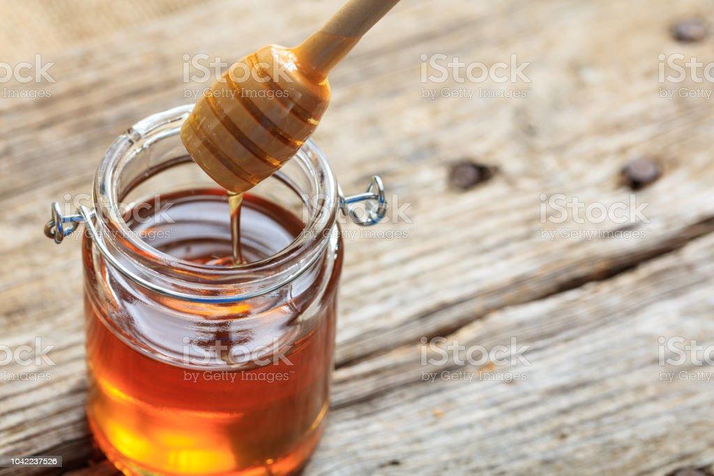 A glass jar with honey - Royalty-free Amarelo Foto de stock