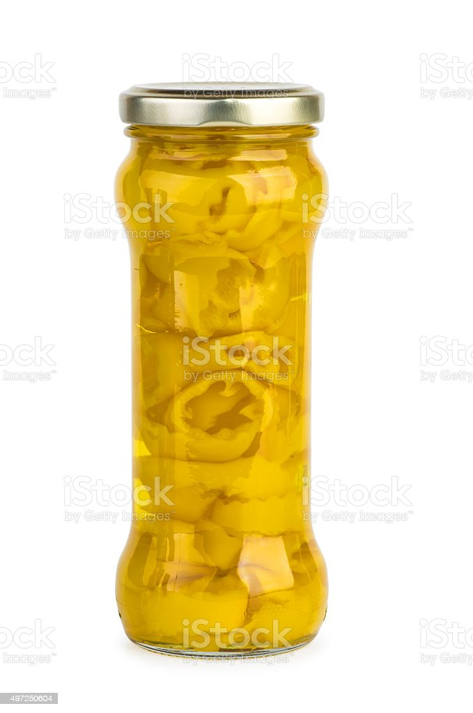 Glass jar with marinated yellow banana pepper slices stock photo