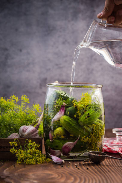Glass jar with pickled cucumbers and gherkins stock photo