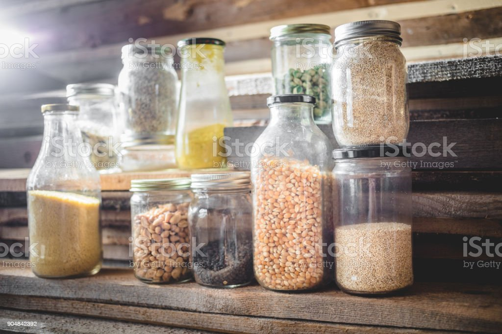 Glass Jars of Spices, Grains and Dry Food stock photo