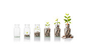 istock Glass jars with coins, savings concept 514070388