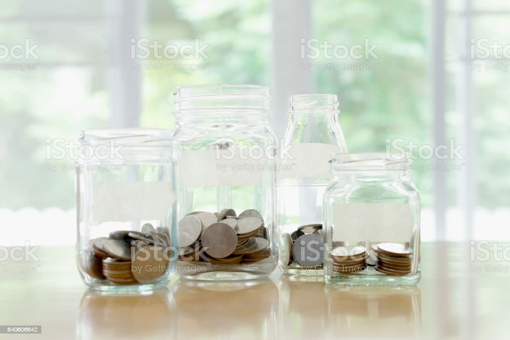 Glass jars with money coins ruble and empty sticker Glass jars with money coins ruble and empty sticker Bank Deposit Slip Stock Photo