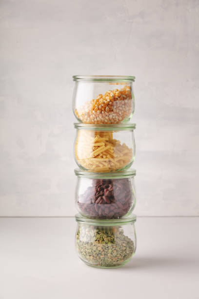 glass jars with pasta, lentils, beans and corn stock photo