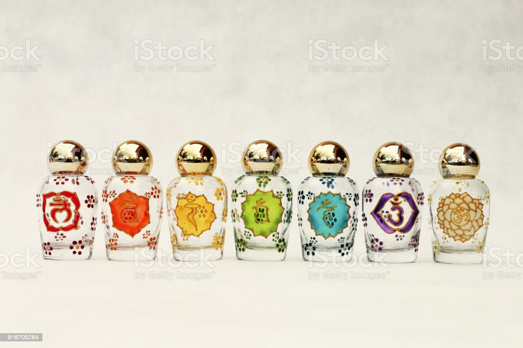 Glass Jars With The Symbols Of The Seven Chakras Stock Photo More