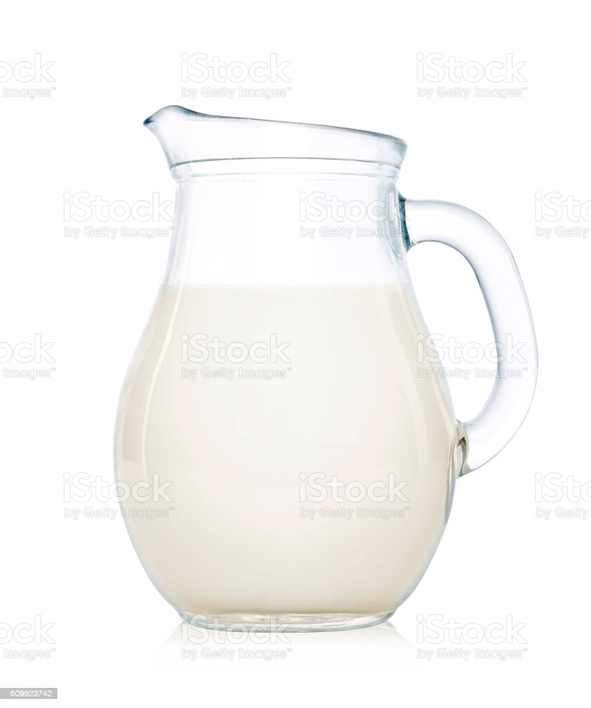 Glass jug of milk isolated on white stock photo