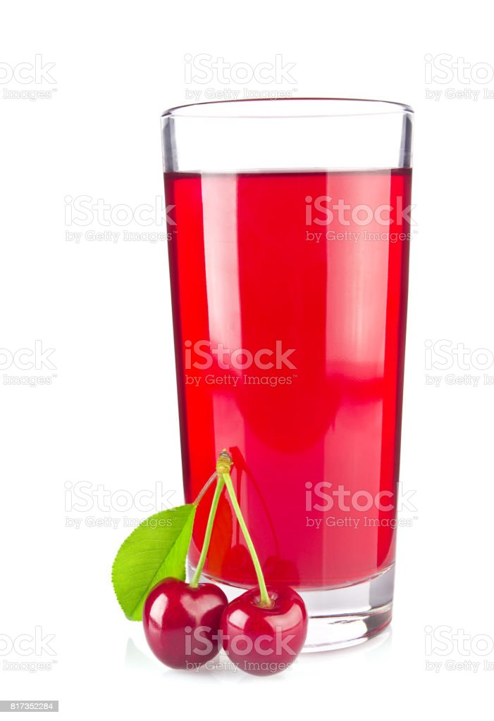 Glass juice and two ripe juicy cherries with green leaf stock photo