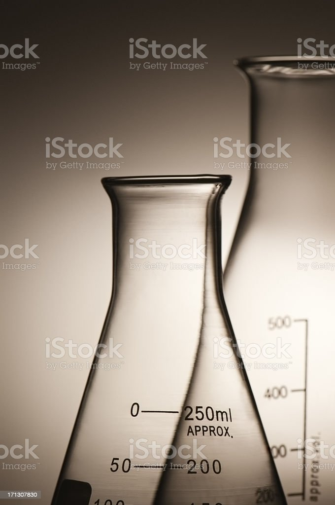 Glass laboratory flasks and beakers in silhouette royalty-free stock photo