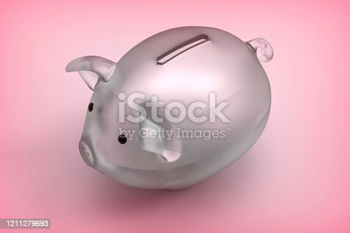 Glass mateial piggy bank on pink background. stock photo