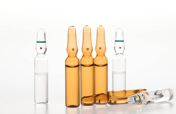 Glass medicine ampoules on a white background stock photo