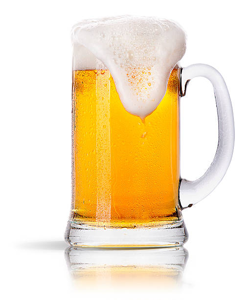 Glass mug of golden beer with foam spilling down the side Frosty glass of light beer set isolated on a white background beer glass stock pictures, royalty-free photos & images