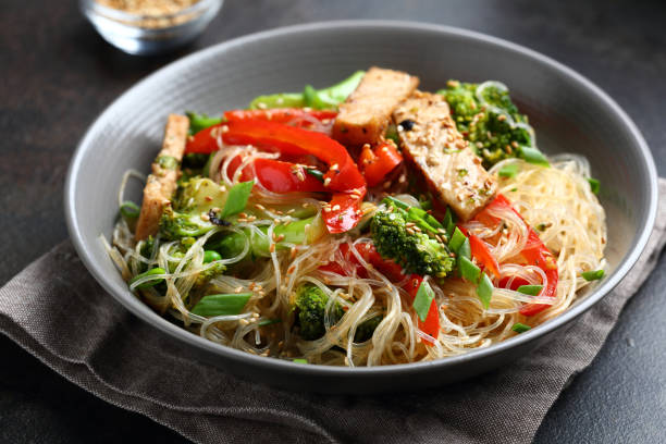 Glass noodles with  stir fry meat, food closeup Glass noodles with  stir fry meat, food closeup rice noodles stock pictures, royalty-free photos & images