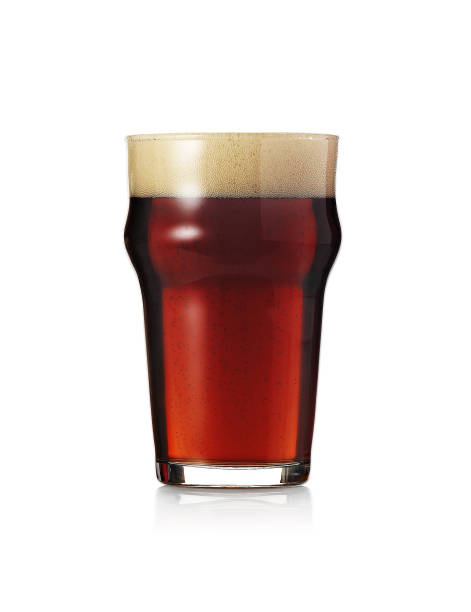 glass of ale beer ale - dark beer stock photos and pictures